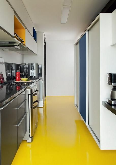 kitchen, yellow seamless floor, white wall and backsplash, silver bottom cabinet, white upper cabinet