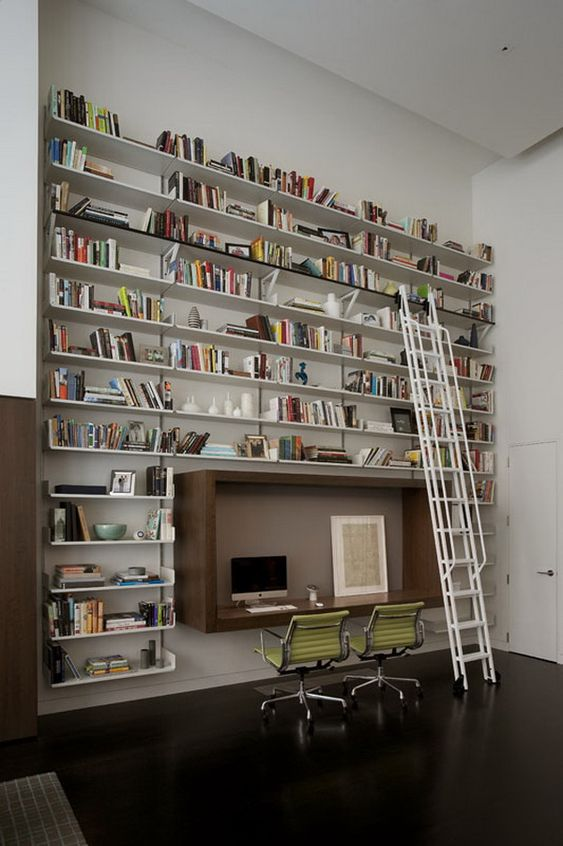 library, dark wooden floor, wooden box table, white wall, white floating book shelves, white stairs