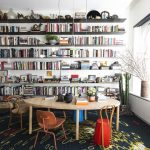 Library, White Wall, Blue Rug, Low Wooden Table And Chairs, Floating Book Shelves