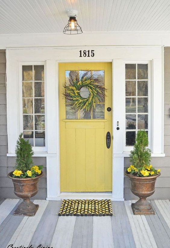 light yellow door, wooden floor, plank wall, pendant, copper pot