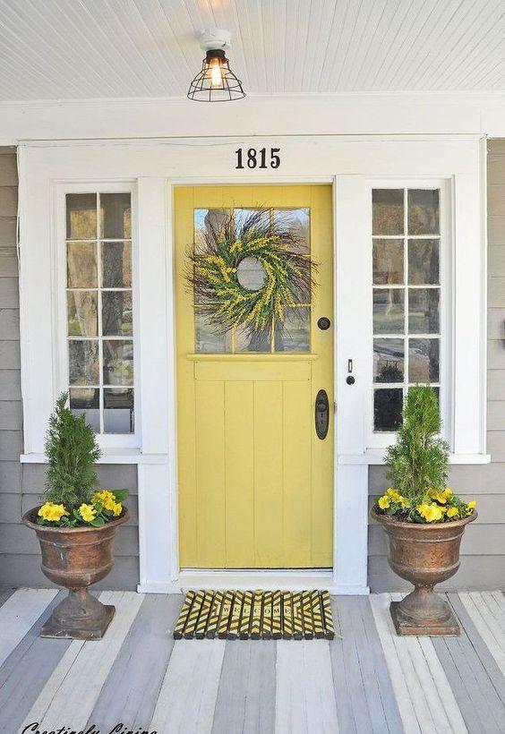 light yellow door, wooden floor, plank wall, pendant, copper pot