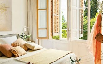 master bedroom, patterned floor tiles, white wall, wooden windows, beige bedding, half round bench