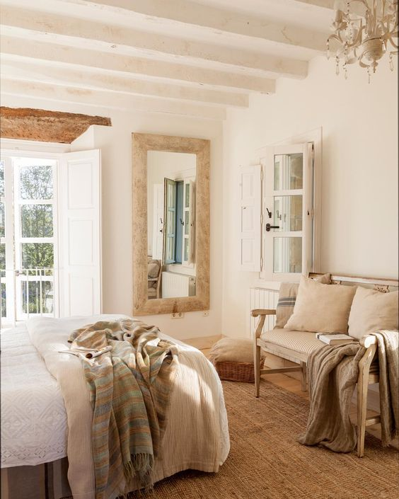 master bedroom, wooden floor, rattan rug, white wall, white ceiling beam, mirror, wooden bench, window with wooden frame