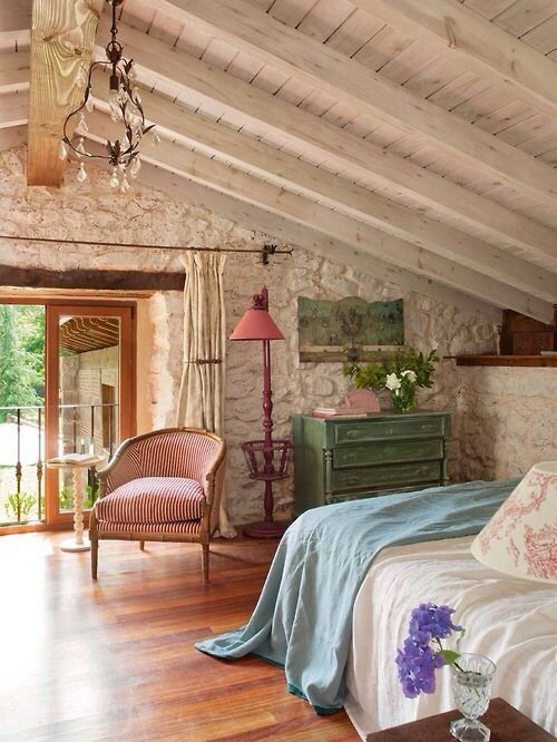 master bedroom, wooden floor, white wooden sloping ceiling, white stone wall, green cabinet, white bedding, blue blanket, pink floor lamp