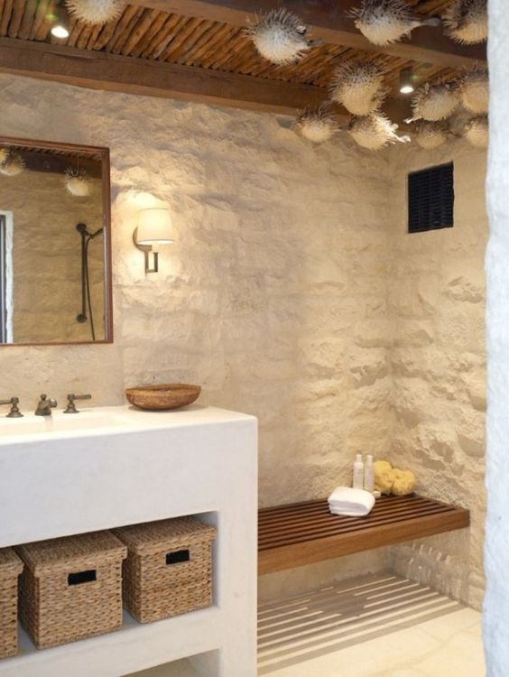 minimalist bathroom, white textured wall, white plastered vanity, rattan basket, mirror, bamboo ceiling