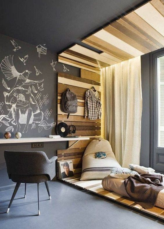 minimalist bedroom, grey seamless floor, grey wall with white mural, grey ceiling, wooden slab platform box the bedroom, white floating table, grey chair