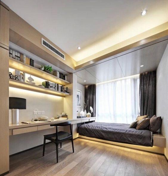 minimalist bedroom, wooden floor, LED lights on bed platform, study corner with shelves, floatnig table, LED lights, black chair