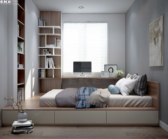 minimalist bedroom, wooden floor, wooden bed platform with storage, built in shelves on the platform, built in floating table on the platform