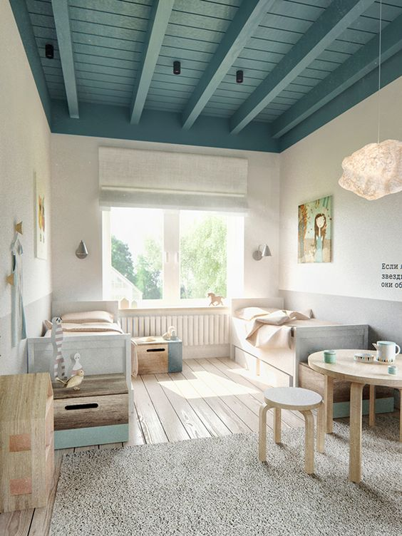 minimalist kids bedroom, wooden flor, grey rug, white grey wall, blue wooden ceiling, round wooden table, round wooden stools, two wooden bed platform with drawers under