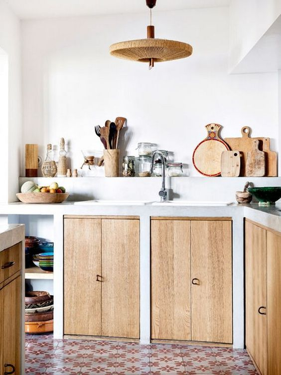 minimalist kitchen, cement cabinet with wooden door, built in shelves, rattan pendant, patterned floor