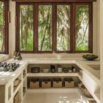 Minimalist Kitchen, Plastered Kitchen Top, Built In Shelves, Rattan Basket, Glass Window, Sink, Stove