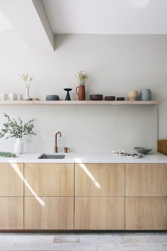minimalist kitchen, wooden bottom cabinet, white kitchen top, sink, off white wall, floating shelves, white marble floor