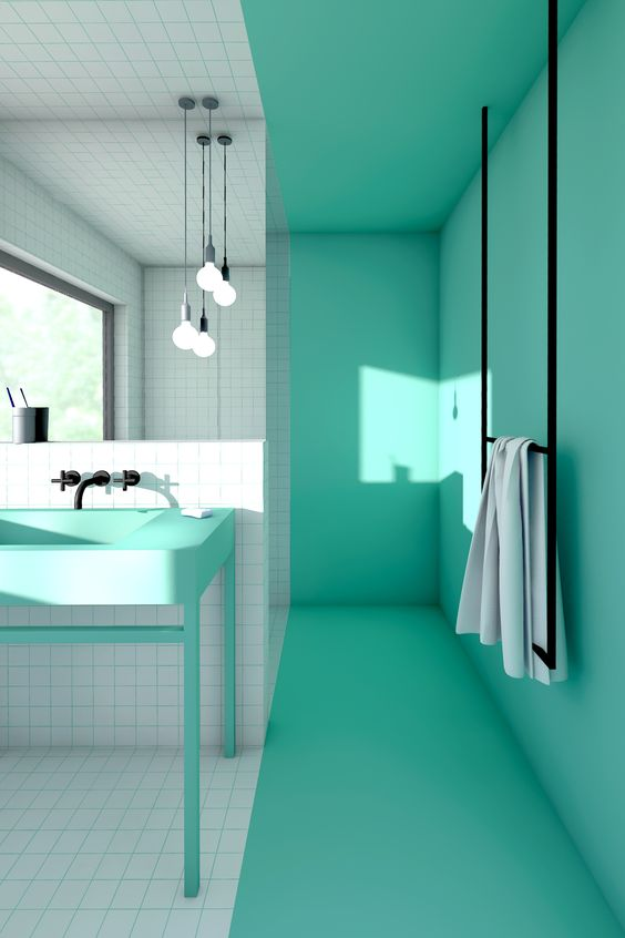 modern bathroom, bright tosca wall, bright tosca vanity, white square tiles on the floor and wall, mirror, pendant