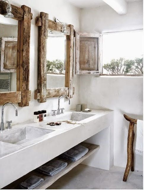 modern bathroom, white plaster cement vanity, wooden framed mirror, wooden rack, silver faucet, wooden shelves