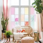 Pastel Color Stained Window Glass, Rattan Sofa, Brown Ottoman, Plants, Golden Side Table, Pastel Rug
