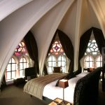 Patterned Stained Glass Window On Dome Ceiling Bedroom, Grey Floor, Black Bed Platform, Black Side Table