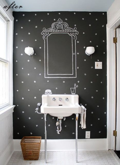 powder room, white floor tiles, white wall, black accent wall, white sink, white sconces, painted mirror