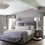 Side Table Decorations Ideas Chandelier Gray Curtains Windows Gray Bed Gray Headboard White Table Lamps Velvet Bench Rug Wooden Floor Pillows Head Statue