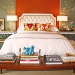 Side Table Decorations Ideas Orange Wall White Tufted Headboard White Bedding Area Rug Wooden Bench Bedside Tables White Table Lamps White Curtain Pillows