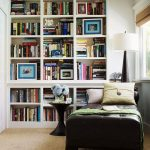Small Corner Library, Built In White Wooden Book Shelves, Black Leathered Lounge Chair, Black Side Table, White Lamp, Near The Window