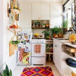 Small Cornered Kitchen, White Bottom Cabinet And Shelves, White Upper Cabinet, White Wall, White Floor Tiles, Colorful Rug, Hanging Sheves