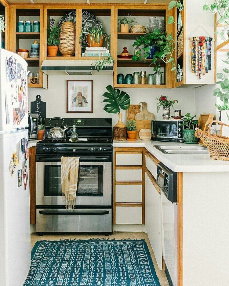 small kitchen, blue rug, white wall, wooden framed upper cabinet, wooden bottom cabinet, white fridge
