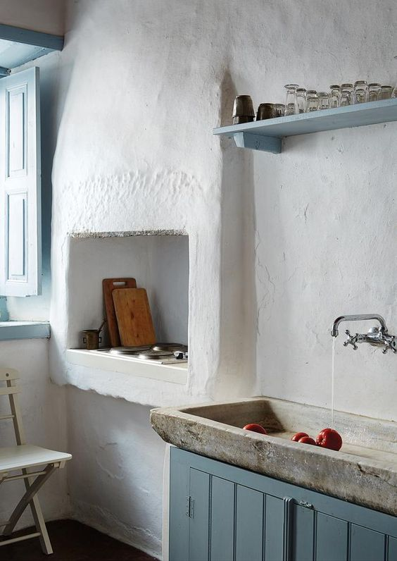 stone sink, blue cabinet, white plastered wall, built in sink, bloting shelves