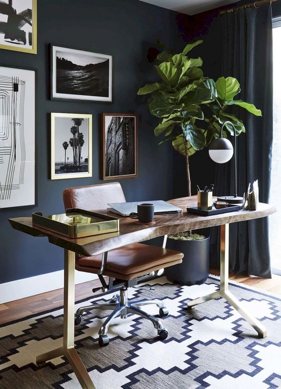 study room, wooden floor, rug, wooden slab table top with golden legs, dark wall, brown leather chair, dark curtain