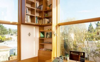 study space, wooden floor, wooden table, wooden bench, wooden chair, woden shelves, large winwos with wooden frame