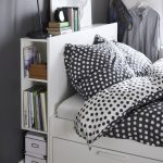 White Wooden Headboard With Shelves, White Wooden Bed Platform With Drawers, Black Table Lamp, Grey Wall