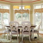 Window Valance White Glass Windows Wooden Floor Patterned Area Rug White Dining Table Pendant Lamps Tan Walls Whte Chairs