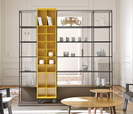woodne bookcase with yellow boxes and wheel