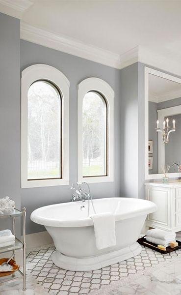 bathroom, white patterned floor tiles, white marble floor tiles, grey wall, white painted window frame, white tub