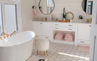 bathroom, whtie wall, white plank wall, white cabinet, white tub, white hexagonal floor tiles, round mirror