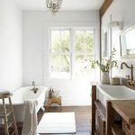 Bathroom, Wooden Floor, White Wall, Chandelier, Wooden Vanity, White Tub, White Rug
