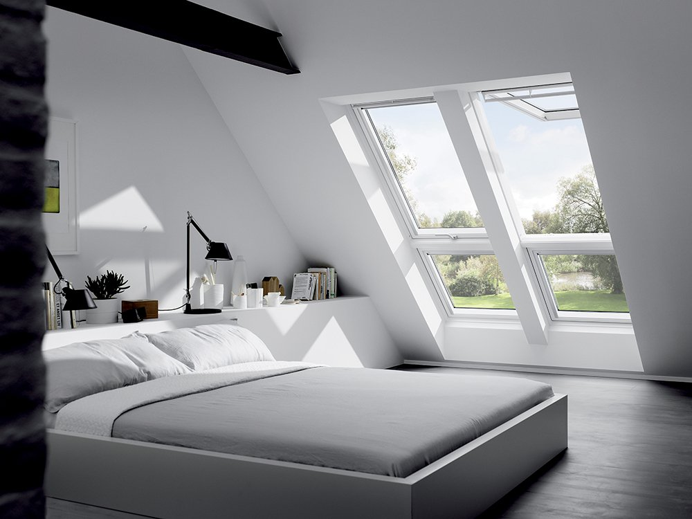 bedroom, dark floor, white wall, white sloping wall, grey bed, white indented wall for shelves