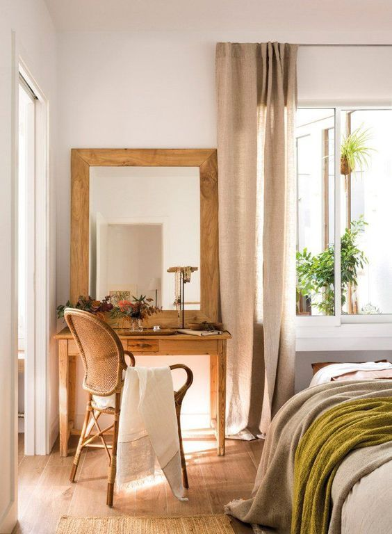 bedroom, wooden floor, wooden make up table, wooden chair, white wall, white curtain, large glass window, grey bedding
