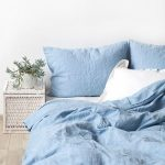 Blue Bedding, Wooden Floor, Rattan Side Table