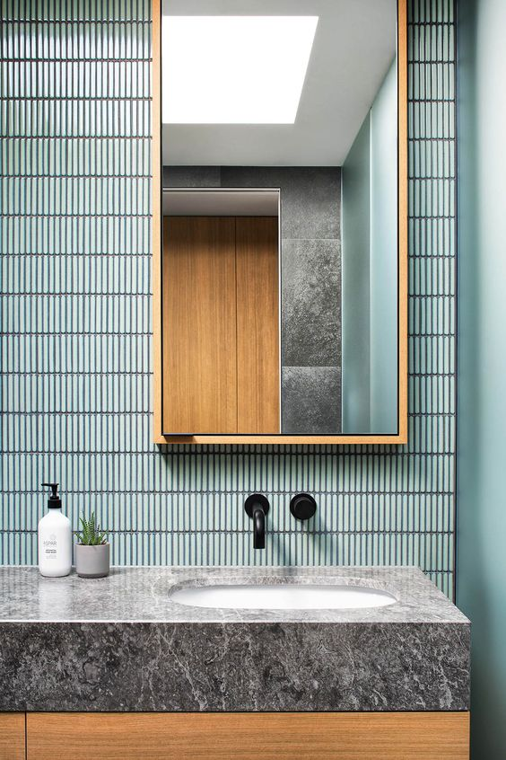 blue tiny backsplash tiles, wooden mirror cabinet, wooden vanity cabinet, grey marble top, black faucet
