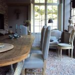 Brick Floor In The Dining Room, Wooden Dining Table, Grey Chairs, White Chair To Read, Cabinet, Chandelier