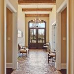 Brick Floor In The Entrance, Beige Wall, Wooden Beams, White Ceiling, Chandelier