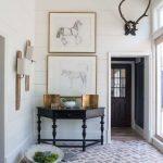Brick Herringbone Floor In The Entrance, White Planks Wall, Black Geometrical Cabinet, Wall Decorations