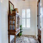Brick Herringbone Floor On The Entrance, White Plank Wall, Pednant, Wooden Cabinet