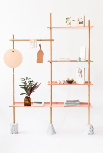 brown thin shelves with white marble support at the bottom