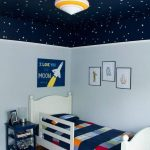 Children Bedroom, Wooden Floor, Light Blue Wal, Dark Blue Ceiling With Stars, Grey Rug, White Bed Platform, Blue Side Table