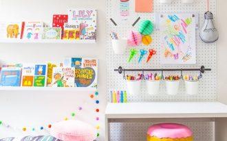 children's study room, white wall, white pegboard, white floating display shelves, grey ru, doughnut stool, white table