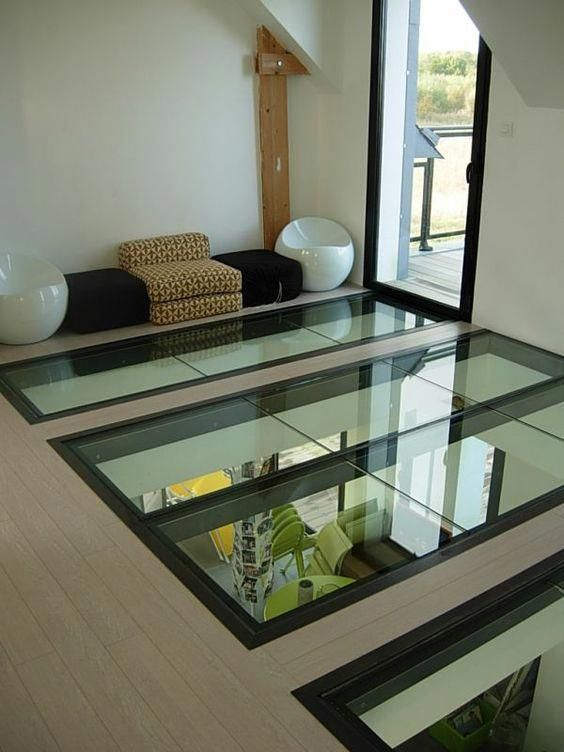 clear glass on the floor, low chairs, white wall