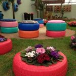 Colorful Reused Wheel With Colorful Cushion And Plants On The Patio