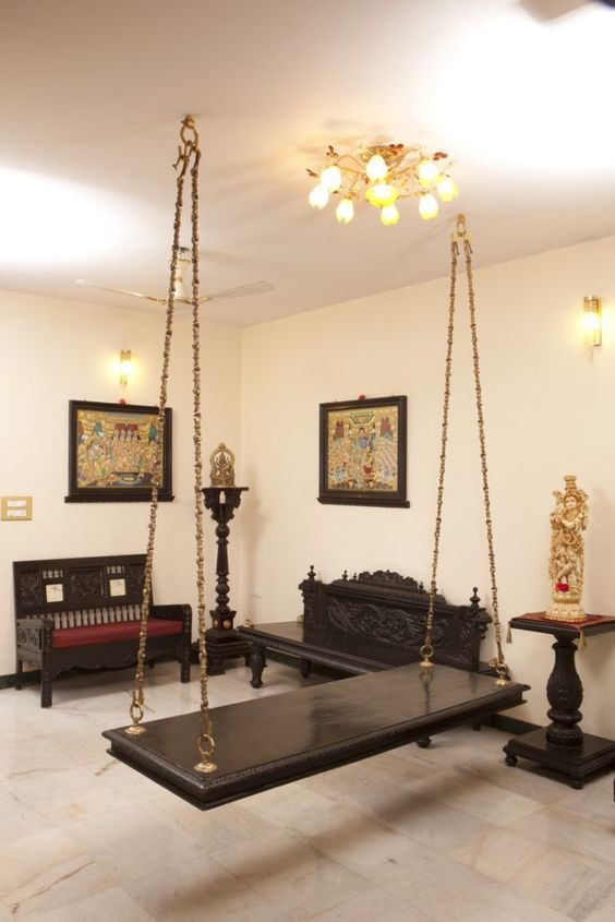 dark brown board swing, golden detailed rail. black benches, black side table