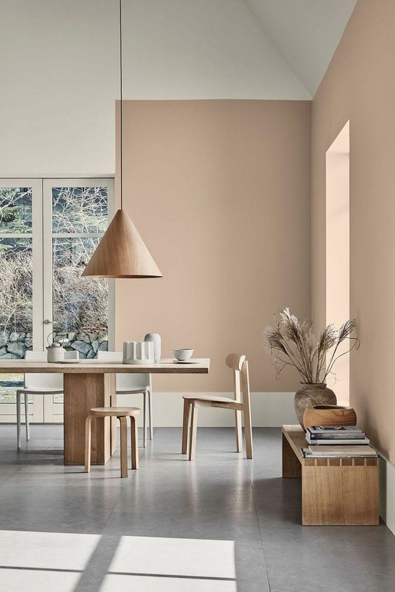 dining room, grey floor, earth wall, white wall, cone pendant, wooden dining set, wooden chairs, stools, wooden bench